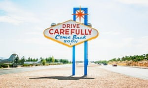 Road sign in Vegas saying Drive Carefully Come Back Soon