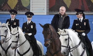 Russian President Vladimir Putin rides a horse on a visit to a mounted police unit in Moscow, Russia.