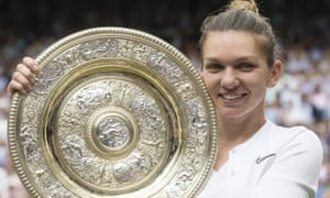 The Wimbledon champion Simona Halep celebrates with the trophy after her victory over Serene Williams in the final.