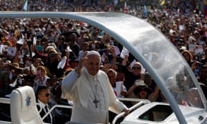 Pope Francis waves at well-wishers as he arrives at the Catholic shrine of Fátima.