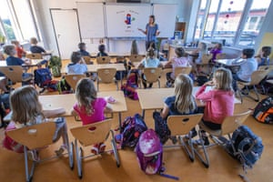Teacher Francie Keller welcoming the pupils of class 3c in her classroom in the Lankow primary school to the first school day after the summer holidays in Schwerin, Germany, on 3 August 2020.