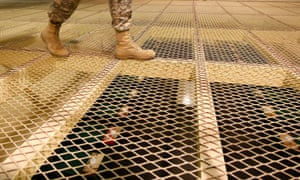 A US soldier walks above detention centre cells at Bagram air base.