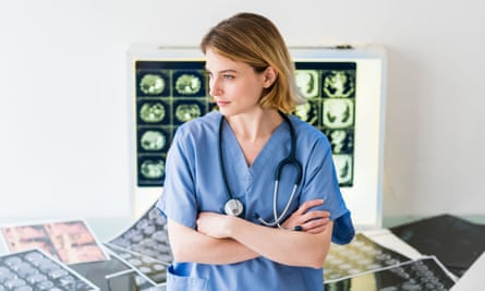 Young doctor in hospital. The GMC says a 'worrying number of doctors in training continue to raise concerns about heavy workloads'.