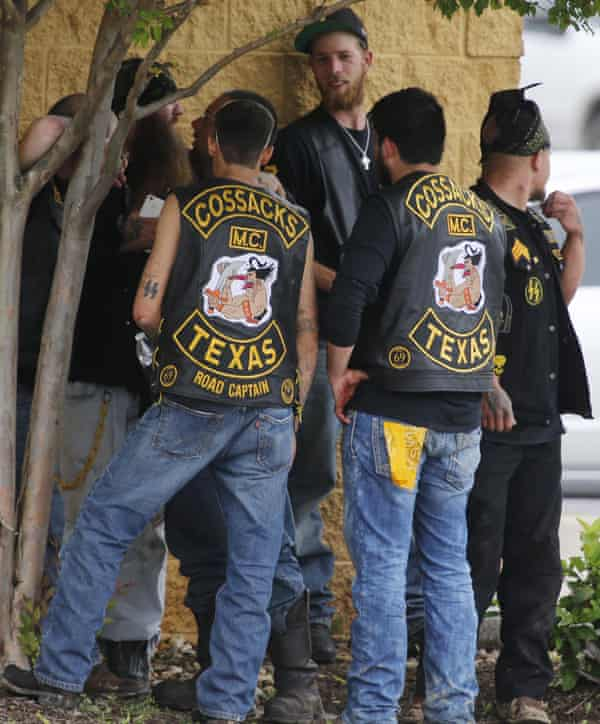 Bikers congregate against a wall on Sunday after the shootout at the Twin Peaks.