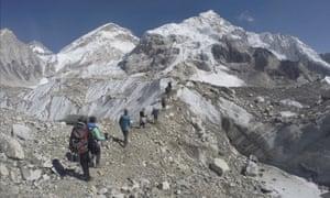 Trekkers cross a glacier at Mount Everest base camp