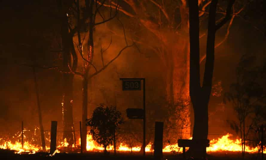 Flames from the Currowan fire impacting properties along the Sussex inlet road on 31 December 2019
