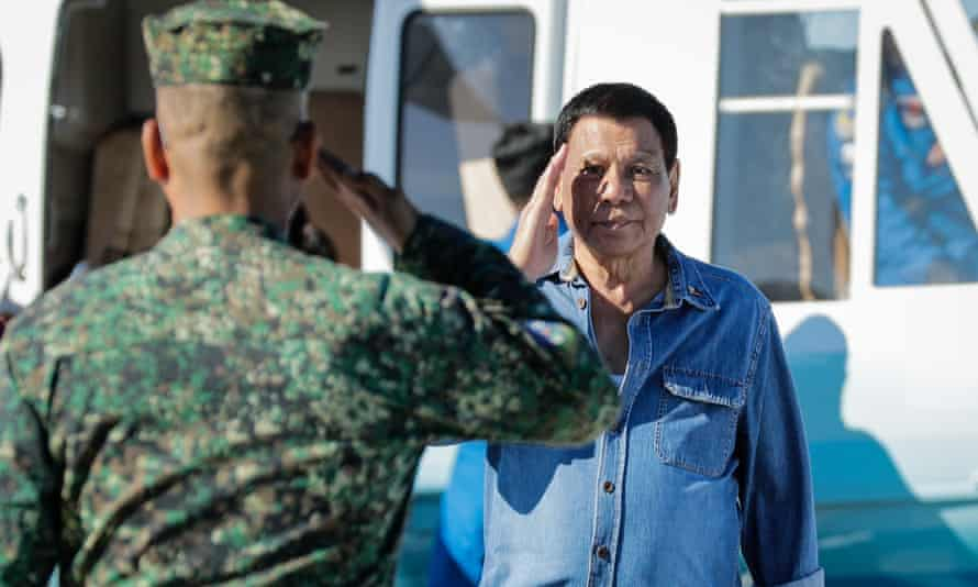 Philippines President Rodrigo Duterte salutes to a military officer