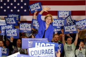 Elizabeth Warren speaks to supporters at a caucus night campaign rally.