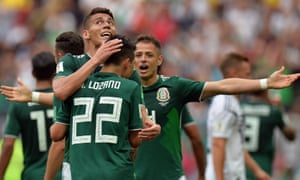 Hirving Lozano celebrates with his Mexico teammates after scoring the first goal of the match.