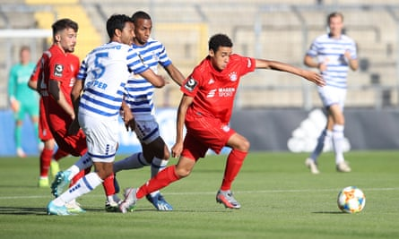Bayern Münich II's Jamal Musiala (right) surges away from a challenge during the 2-2 drawa against Duisburg in July 2020.
