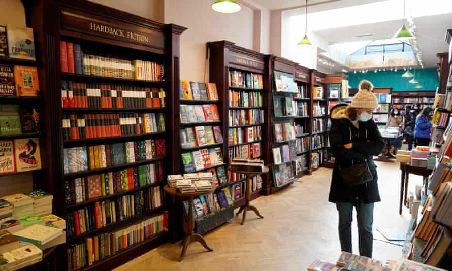 Customers browse inside Daunt Books in London, on 12 April, the day bookshops reopened across England and Wales.