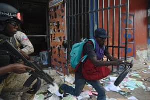Port-au-Prince, HaitiHaitian Police try to arrest a man who was caught looting a shop in the centre of Haitian Capital, as a sixth day of protests against Haitian President Jovenel Moise and the misuse of Petrocaribe funds continued.