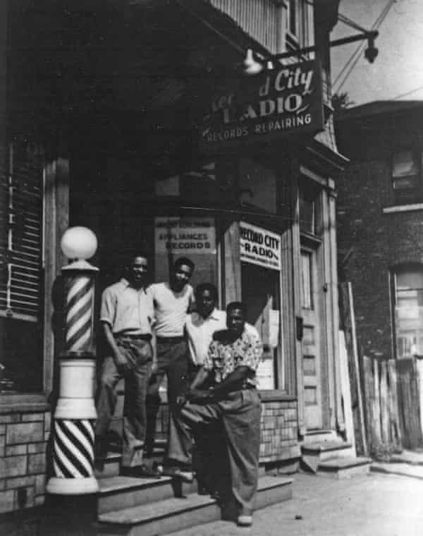David Wilkins, the owner of Record City Radio, poses with three others outside his store. The store, once across the street from I-81, no longer stands today.