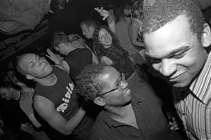 """Paradise Factory 8th Birthday, 2001 – Al Baker """"In the centre of this shot you can see DJ Claud Cunningham cutting some rug at Paradise Factory. Claud started alt-queer club Black Angel in 1999 with the aim of providing a safe hangout for black, Asian and minority ethnic women in Manchester."""""""