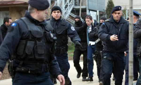 Kosovo police arrest Marko Đurić during his visit to Mitrovica on 26 March.