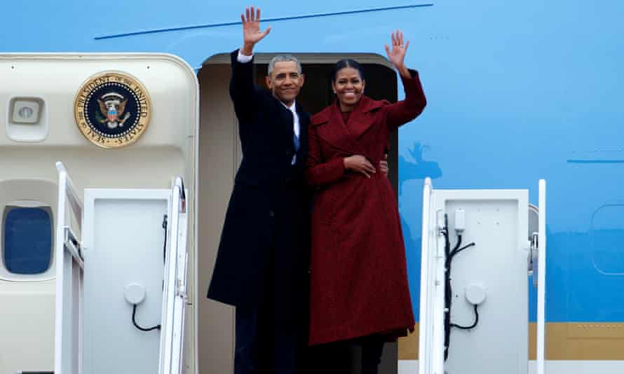 Barack and Michelle Obama wave goodbye.