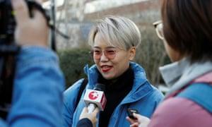 Teresa Xu talks to journalists outside a Beijing court.