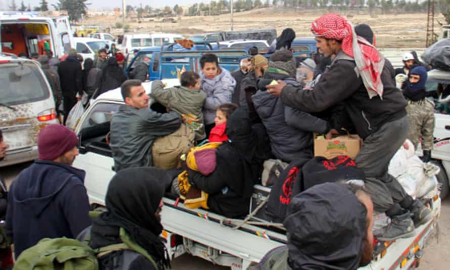 Syrian rebel fighters and civilians evacuated from Aleppo arrive in the opposition-controlled Khan al-Aassal region, west of the city.