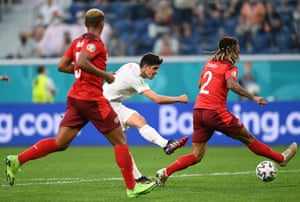 Gerard Moreno (centre) of Spain fires in a shot.