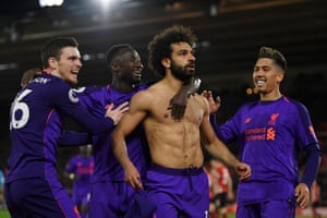 Salah celebrates with Firmino and Robertson.