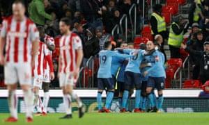 Newcastle United's Ayoze Pérez celebrates scoring their first goal at Stoke City.