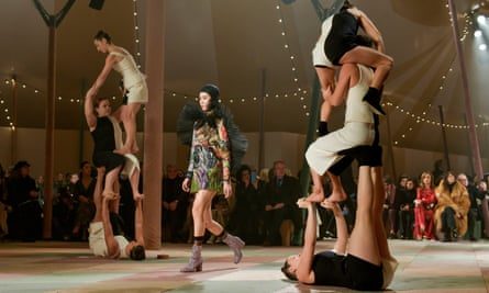 Models and acrobats on the Christian Dior haute couture show.