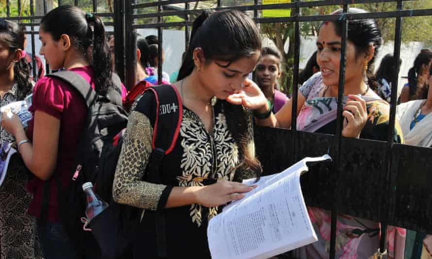 A student does some last minute revising before sitting her Secondary School Certificate (SSC) in Mumbai.