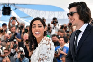 Golshifteh Farahani and Adam Driver pose during a photocall for the film Paterson