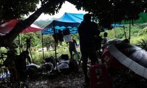 Members of the media report from a hill near the Tham Luang cave area as the operations continue for those still trapped inside the cave