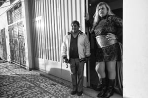 Serena stands at the entrance to the ballroom with her friend Miguel Angel, waiting for the guests to arrive at her birthday party