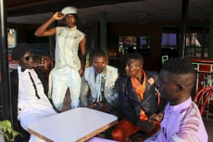 Models pose for a picture in bazin outfits made by designer Barros Coulibaly