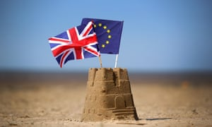 Sandcastle with British and EU flags