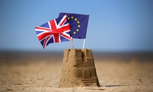 EU and UK flags on top of a sandcastle