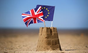 Two sandcastles with an EU anb Union flag