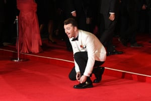 Sam Smith sorts out his laces on the red carpet