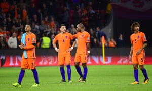 The Holland players react to the disappointment of failing to qualify for their second major football tournament in a row.