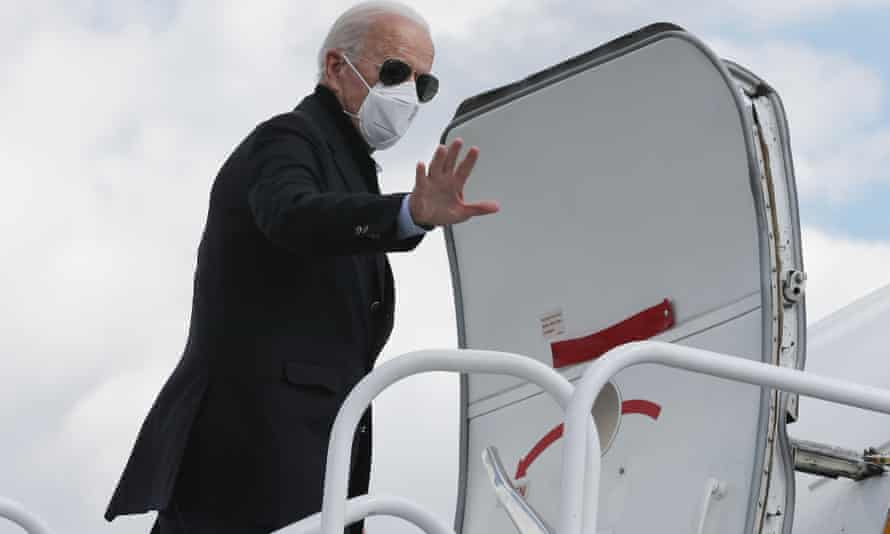 Joe Biden boards his campaign plane before traveling to Grand Rapids, Michigan, on 2 October.