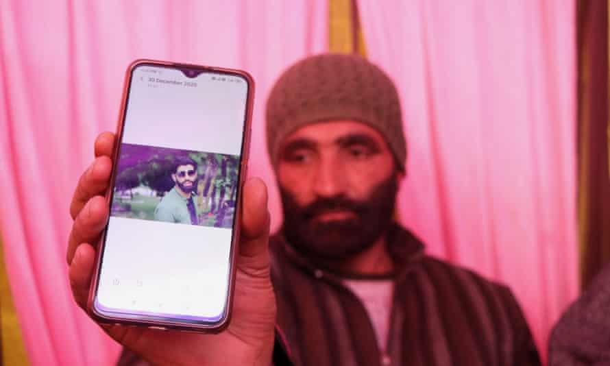 Mohammad Maqbool Ganai shows a picture of his son, Aijaz Maqbool.