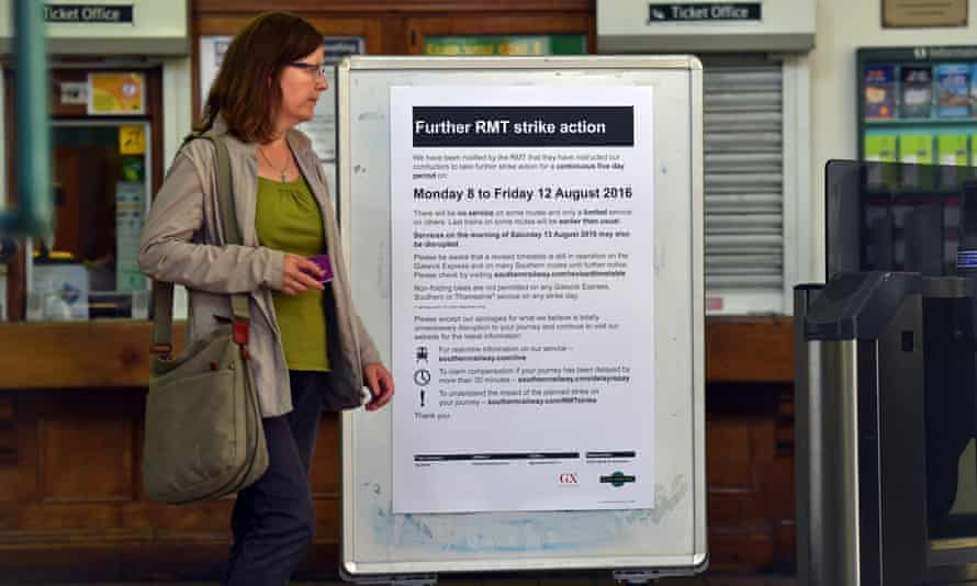 A sign informs passengers of industrial action on Southern at Peckham Rye station in south-east London