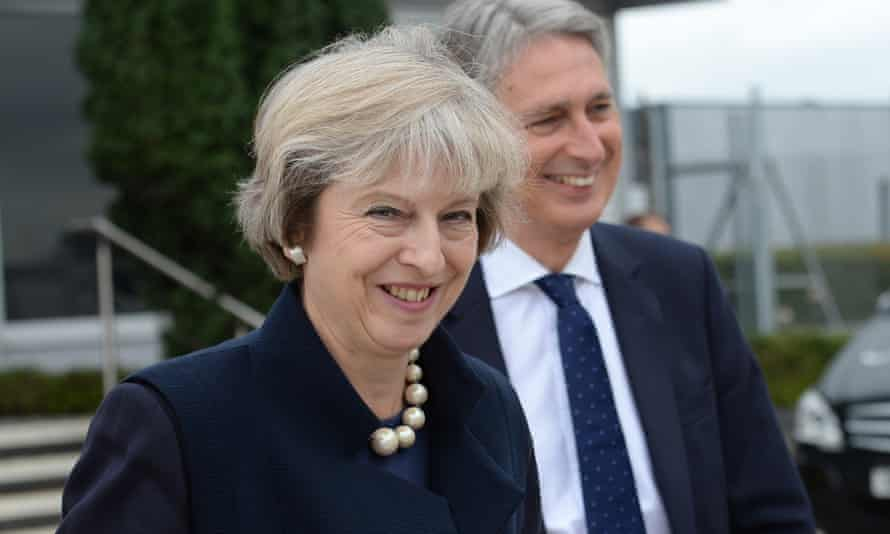 Theresa May and chancellor Philip Hammond at Heathrow airport before she boarded a plane for the G20 summit in China.