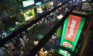 An illuminated sign for Myanmar Beer, manufactured by Myanmar Brewery Ltd, in the Chinatown area of Yangon, Myanmar