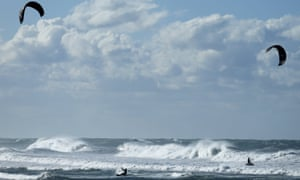 Kitesurfers take advantage of strong winds in Cardiff, California, on Monday.