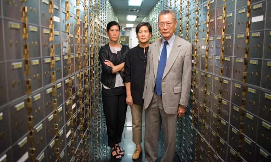 vera jill and thomas sung of abacus federal savings bank standing in a bank vault