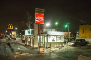 Night view of Telway Hamburgers, a popular 24-hour dive, 6820 Michigan Ave in Martin, Detroit, 2015. In order to make these photographs, Camilo stands on the roof of his car