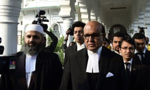 Jamaat-e-Islami leader Motiur Rahman Nizami's lawyer Khandker Mahbub Hossain (centre) arrives at the supreme court following a review petition relating to his appeal against his death sentence on Wednesday.