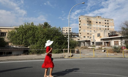 A woman walks through a newly-opened street in Varosha, Cyprus, in October.