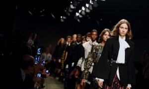 Models on Burberry's 'see now, buy now' catwalk during London Fashion Week last week.