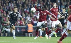Amir Abrashi of Albania in action against Denmark's Pione Sisto and Pierre-Emile Hoejberg.