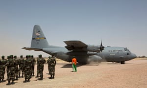 A C-130 US air force plane lands as Nigerien soldiers stand in formation during a joint exercise in Diffa, Niger in 2014.