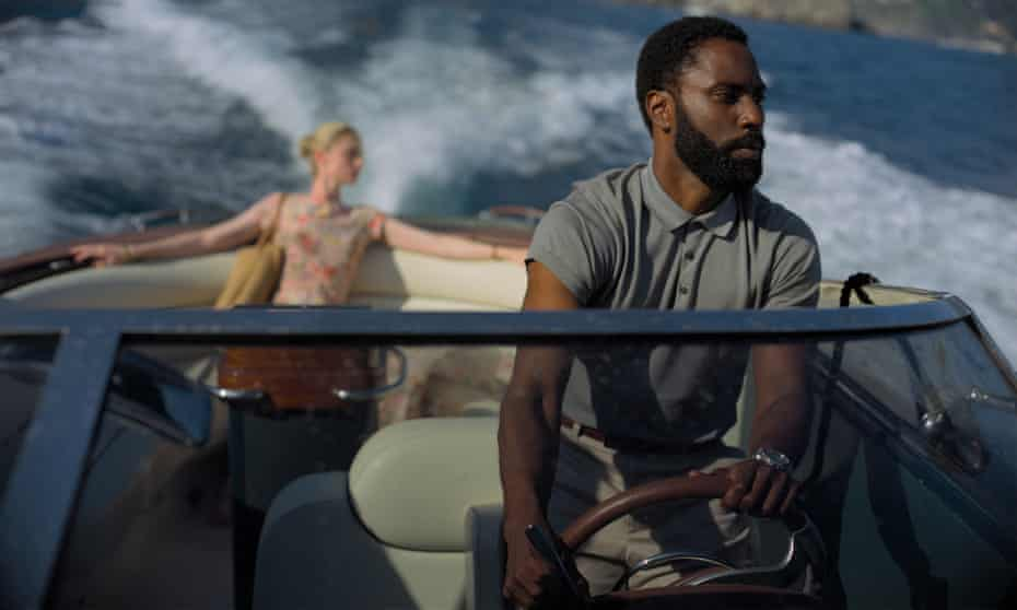 """This image released by Warner Bros. Entertainment shows Elizabeth Debicki, left, and John David Washington in a scene from """"Tenet."""" Warner Bros. will release Christopher Nolan's """"Tenet"""" internationally first on Aug. 26, with a U.S. release in select cities to follow over Labor Day weekend. Warner Bros. (Melinda Sue Gordon/Warner Bros. Entertainment via AP)"""